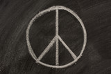 peace symbol sketched with white chalk on a blackboard poster