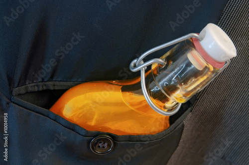 hip flask with elixir in breast pocket