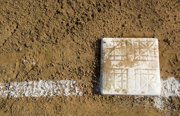 Empty base on chalked baseball field,
