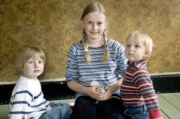 three children sitting together with thier pet gerbills