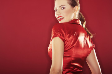 On red background girl with red lipstick - sexy portrait