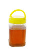 Jar of honey with lid on white background