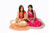Two beautiful harem girls or belly dancers or Hindu brides poster