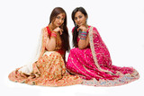 Fototapety Two beautiful harem girls or belly dancers or Hindu brides