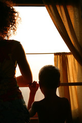 mother with sun silhouette in train