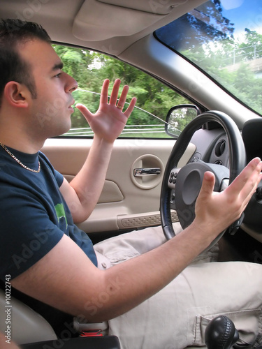 A young man seems to be experiencing some road rage.
