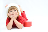 Christmas kid in Santa hat on white background