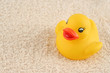 child's rubber duck on top of towel ready for bath time