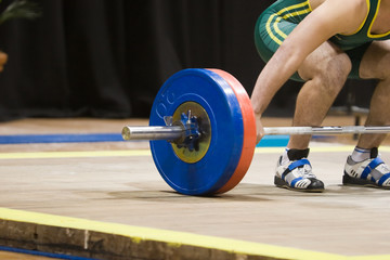 A weightlifter about to lift