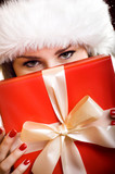 woman is hidden behind a christmas gift poster