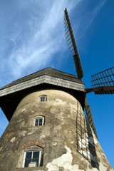 Traditional Old dutch windmill in Latvia against blue sky
