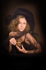 Young lady with a gold coffee cup