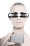 Cyber woman holding silver gadget poster