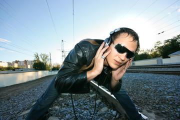 DJ Roman Kravtsov standing on the rails