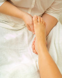 Beauty therapist hands massaging foot or pedicure poster