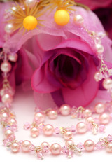 A pink beads necklace put with flower