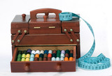 Wooden drawers with spools of threads and measuring tape poster