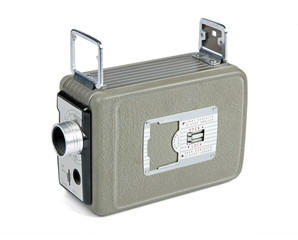 Retro movie camera for 8mm film isolated on white background
