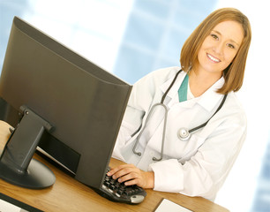 doctor woman work with computer in her modern office