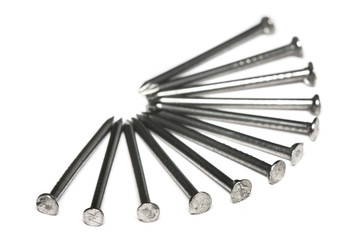 A few nails aligned in fan-shaped on white background.