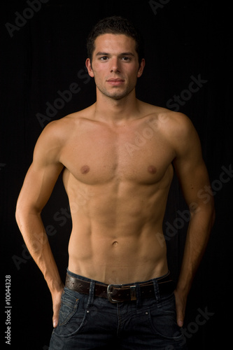 young sensual man on a black background