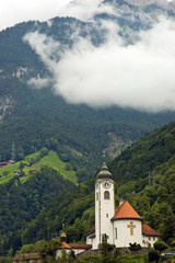 Alpine church in mountains