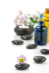 Pebbles, candle, essential oils and flowers. Selective focus