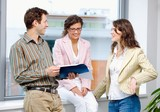 Happy young businesspeople having meeting at office poster