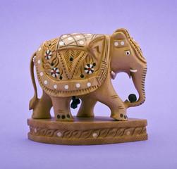 Elephant figurine close-up isolated on violet background