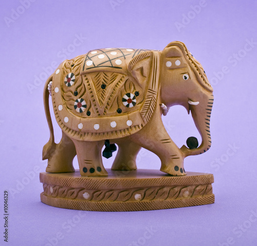 Elephant figurine close-up isolated on violet background