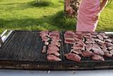 Fresh steak of tuna preparing on grill poster