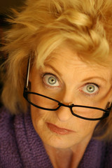 Portrait of woman with glasses giving dissaproving look