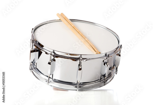 A new silver snare drum with sticks on a white background