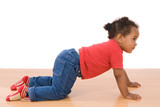 Adorable african baby crawl over wooden floor poster