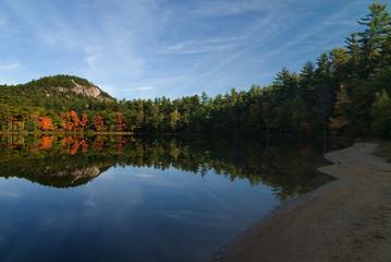 Beautiful fall colors reflecting onto Echo Lake New Hampshire.