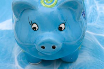 Blue piggy bank on blue background , savings