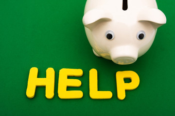 Piggy bank and the word help , financial help