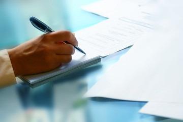 businessman hand write message in note