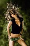 Fototapety sexy woman in shorts dancing, studio shot