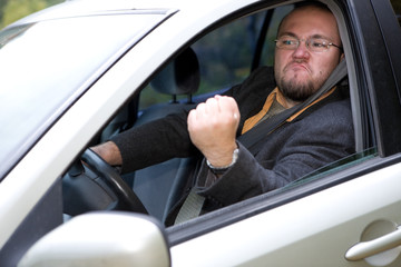 angry man driving by car