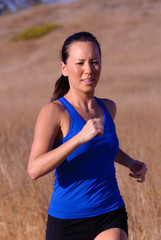 beautiful asian woman runner on a bright afternoon