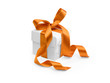 present box with orange ribbon isolated on white background