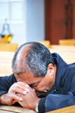 African american man praying in church. poster