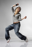 Fototapety young and stylish dancer posing on grey