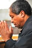 African american man praying in church. poster