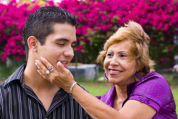 grandmother senior woman caressing teen boy  face