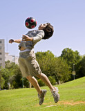 Fototapety teenager boy and ball in the park