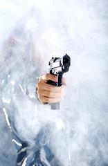 Sexy girl wearing black dress holding gun