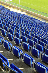 Blue seats on stadium (free before football match)