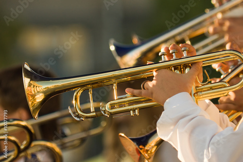 young musicians are playing on trombones - 10077793